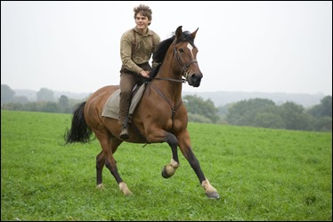 """WAR HORSE""..DM-AC-25226..Albert Narracott (Jeremy Irvine) joyfully rides atop his beloved horse, Joey in DreamWorks Pictures' ""War Horse"", director Steven Spielberg's epic adventure and an unforgettable odyssey through courage, friendship, discovery and wonder...Ph: Andrew Cooper, SMPSP..©DreamWorks II Distribution Co., LLC. ÊAll Rights Reserved."
