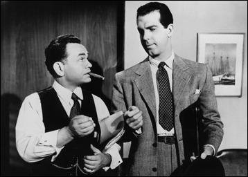 Fred MacMurray le enciende por enésima vez una cerilla a Edward G. Robinson en Perdición